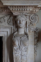An original Georgian caryatid on a fire surround that survived the fire in the drawing room