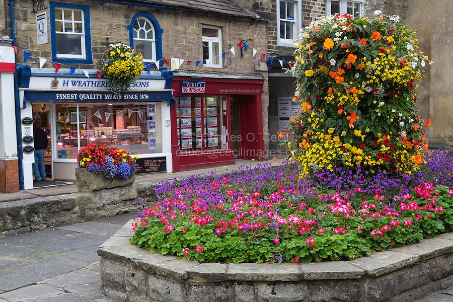 UK, England, Pateley Bridge, Yorkshire.  Village Square, Flowers, and Shops.