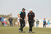 Paul Lawrie and Peter Hanson chat during the second round of the  2012 Commercial Bank Qatar Masters being played over the Championship Course at Doha Golf Club, Doha, Qatar from 2nd to 5th February 2012. Picture Stuart Adams www.golftourimages.com: 4th February 2012