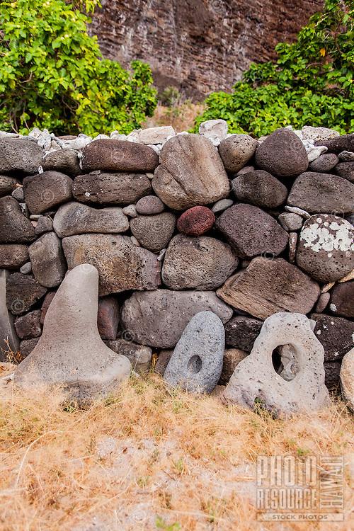 Hawaiian stone anchors along stone wall canoe shelter in Nualolo Kai village, Na Pali Coast, Kaua'i