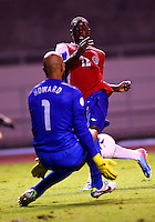 SAN JOSE, COSTA RICA - September 06, 2013: Tim Howard (1) of the USA MNT stops a shot from Joel Campbell (12) of the Costa Rica MNT during a 2014 World Cup qualifying match at the National Stadium in San Jose on September 6. USA lost 3-1.