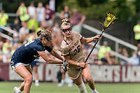NEWTON, MA - MAY 22: Cara Urbank #26 of Boston College on the attack as Keelin Schlageter #44 of Notre Dame defends during NCAA Division I Women's Lacrosse Tournament quarterfinal round game between Notre Dame and Boston College at Newton Campus Lacrosse Field on May 22, 2021 in Newton, Massachusetts.