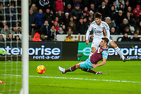 Ki Sung-Yueng of Swansea tries a shot on goal during the Barclays Premier League match between Swansea City and West Ham United played at the Liberty Stadium, Swansea  on December 20th 2015