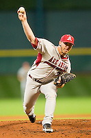 Relief pitcher Colby Suggs #34 of the Arkansas Razorbacks delivers a pitch to the plate against the Houston Cougars at Minute Maid Park on March 3, 2012 in Houston, Texas.  The Cougars defeated the Razorbacks 4-1.  Brian Westerholt / Four Seam Images