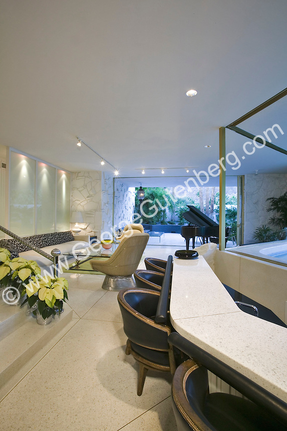 Contempory living room with wet bar and grand piano in background