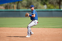 Los Angeles Dodgers second baseman Sam McWilliams (9) prepares to make a throw to first base during an Instructional League game against the Oakland Athletics at Camelback Ranch on October 4, 2018 in Glendale, Arizona. (Zachary Lucy/Four Seam Images)