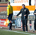 Hibs' manager Alan Stubbs has a word with the stand side assistant referee.