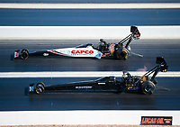 Nov 3, 2019; Las Vegas, NV, USA; NHRA top fuel driver Steve Torrence (far) races alongside Mike Salinas during the Dodge Nationals at The Strip at Las Vegas Motor Speedway. Mandatory Credit: Mark J. Rebilas-USA TODAY Sports