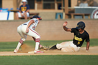 Dominic Byers (5) (Wingate University) of the Statesville Owls slides into third base under the tag from DeAngelo Giles (23) (NC State) of the High Point-Thomasville HiToms at Finch Field on July 19, 2020 in Thomasville, NC. The HiToms defeated the Owls 21-0. (Brian Westerholt/Four Seam Images)