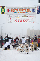 Paul Gebhardt and team leave the ceremonial start line at 4th Avenue and D street in downtown Anchorage during the 2013 Iditarod race. Photo by Jim R. Kohl/IditarodPhotos.com