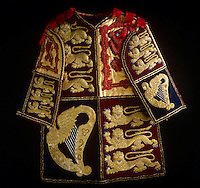 A velvet tabard worn by Garter King of Arms, which was probably made for Queen Victoria's Coronation of 1838, as it bears the Royal Arms