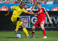 23 April 2011: Columbus Crew defender Julius James #26 and Toronto FC midfielder Jacob Peterson #23 in action during a game between the Columbus Crew and the Toronto FC at BMO Field in Toronto, Ontario Canada..The game ended in a 1-1 draw.