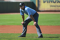 Base umpire Patrick Sharshel in the field as the Ogden Raptors faced the Billings Mustangs in Pioneer League play at Lindquist Field on August 18, 2013 in Ogden Utah.  (Stephen Smith/Four Seam Images)