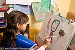 Education Preschool 3-4 year olds art activity girl painting recognizable human figure horizontal