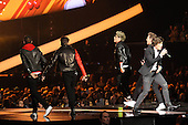 ONE DIRECTION - L-R: Liam Payne, Louis Tomlinson, Niall Horan, Harry Styles, Zayn Malik - performing live at the 2013 Brit Awards held at the O2 Arena in London UK - 20 Feb 2013. Photo credit: George Chin/IconicPix/AtlasIcons.com