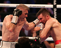9th October 2021; M&S Bank Arena, Liverpool, England; Matchroom Boxing, Liam Smith versus Anthony Fowler; LIAM SMITH (Liverpool, England)left to the head of ANTHONY FOWLER (Liverpool, England) during their WBA International Super-Welterweight Title contest