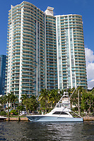 Ft. Lauderdale, Florida.  Pleasure Boat Parked in front of Water Garden Condominium on New River.