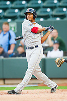 Xander Bogaerts #23 of the Salem Red Sox follows through on his swing against the Winston-Salem Dash at BB&T Ballpark on May 5, 2012 in Winston-Salem, North Carolina.  The Red Sox defeated the Dash 6-4.  (Brian Westerholt/Four Seam Images)