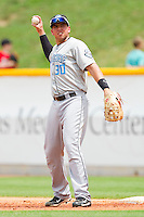 First baseman Chris Marrero #30 of the Syracuse Chiefs throws the ball back to his pitcher during the game against the Charlotte Knights at Knights Stadium on June 19, 2011 in Fort Mill, South Carolina.  The Knights defeated the Chiefs 10-9.    (Brian Westerholt / Four Seam Images)
