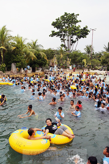 People enjoy Ancol Water Park in northern Jakarta.<br /> <br /> To license this image, please contact the National Geographic Creative Collection:<br /> <br /> Image ID:  1574991<br />  <br /> Email: natgeocreative@ngs.org<br /> <br /> Telephone: 202 857 7537 / Toll Free 800 434 2244<br /> <br /> National Geographic Creative<br /> 1145 17th St NW, Washington DC 20036