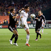 Juan Pablo Angel (9) of the LA Galaxy takes a touch on the ball in front of Dejan Jakovic (5) of D.C. United during the game at RFK Stadium.  D.C. United tied the LA Galaxy, 1-1.