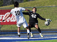 NWA Democrat-Gazette/CHARLIE KAIJO Rogers High School goalkeeper Anthony Garcia (42) blocks an attempt during a soccer game, Friday, April 26, 2019 at  Whitey Smith Stadium at Rogers High School in Rogers.