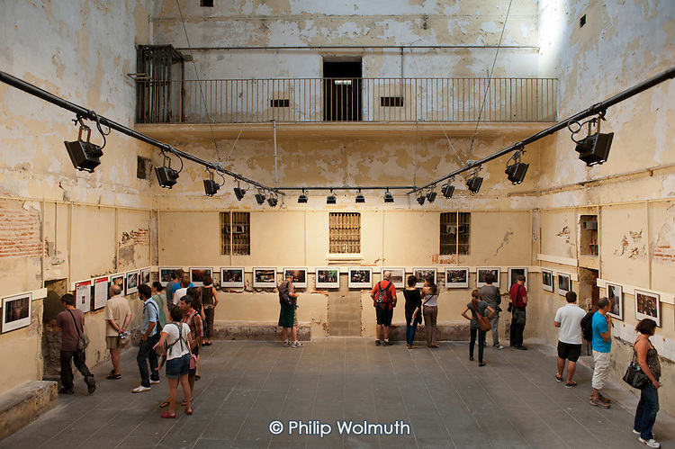 Fernando Moleres exhibition Juveniles behind Bars in Africa, shown in a disused prison at the  Visa Pour L'Image festival of photojournalism, Perpignan, France.