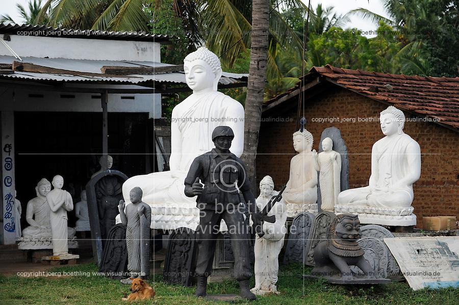 SRI LANKA, new buddhist stupa construction is going on after war against  the LTTE tamil tigers, buddha and singhalese soldier sculptures in sculpture workshop / SRI LANKA, nach dem Sieg gegen die LTTE Tamil Tiger werden in tamilischen Gebieten auffaellig viele neue buddhistische Stupa gebaut, Werkstatt eines Skulpteurs, Buddha Figuren und Skulptur eines singhalesischen Soldaten