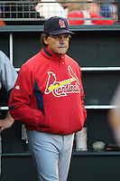 SAN FRANCISCO - APRIL 24:  Manager Tony La Russa #10 of the St. Louis Cardinals stands in the dugout during the game against the San Francisco Giants at AT&T Park on April 24, 2010 in San Francisco, California. Photo by Brad Mangin