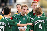 Austin Bowers (27), Andrew Olsen (7), and Aaron Gaide (4) of the Dartmouth Big Green celebrate after the game. Dartmouth defeated Monmouth 4-0 during the first round of the 2010 NCAA Division 1 Men's Soccer Championship on the Great Lawn of Monmouth University in West Long Branch, NJ, on November 18, 2010.