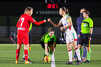 Maurane Marinucci (7 Standard) gives a fist bump to Lenie Onzia (8 OHL) before a female soccer game between Oud Heverlee Leuven and Standard Femina De Liege on the 10th matchday of the 2020 - 2021 season of Belgian Womens Super League , sunday 20 th of December 2020 in Heverlee , Belgium . PHOTO SPORTPIX.BE | SPP | SEVIL OKTEM