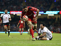 Pictured: Waisea Nayacalevu of Fiji (R) fails to stop Taulupe Faletau on his run for a try for Wales. Saturday 15 November 2014<br />