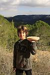 Israel, Jerusalem Mountains, Noam Isachar with a mushroom on Mount Eitan