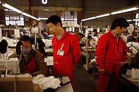 Taiwanese technicians at Precious Garment textile factory.