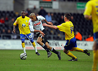 ATTENTION SPORTS PICTURE DESK<br /> Pictured: Darren Pratley of Swansea (L) breaks away from Darren Potter of Sheffield Wednesday (R)<br /> Re: Coca Cola Championship, Swansea City Football Club v Sheffield Wednesday at the Liberty Stadium, Swansea, south Wales. Saturday 13 Marchy 2010