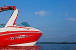 USA, Missouri, Stockton, Stockton Lake, red motorboat on lake