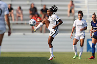 CARY, NC - SEPTEMBER 12: Crystal Dunn #19 of the Portland Thorns FC settles the ball during a game between Portland Thorns FC and North Carolina Courage at Sahlen's Stadium at WakeMed Soccer Park on September 12, 2021 in Cary, North Carolina.