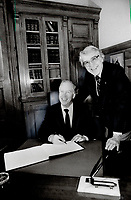 1985 FILE PHOTO - ARCHIVES -<br /> <br /> Ontario Premier Frank Miller flashes a wide grin as he signs in at Queen's park yesterday after being sworn in as an MPP by clerk of the Legislature Roderick Lewis, right. Miller later called the Liberal-NDP deal to oust his government an unholy alliance<br /> <br /> 1985<br /> <br /> PHOTO :  Erin Comb - Toronto Star Archives - AQP