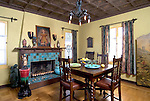Dining room with a fireplace, chandelier, hardwood floors, and dining room table. California
