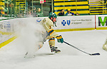 17 December 2013:  University of Vermont Catamount Forward Chris McCarthy, a Senior from Collegeville, PA, stops in his own end during the first period against the Northeastern University Huskies at Gutterson Fieldhouse in Burlington, Vermont. The Huskies shut out the Catamounts 3-0 to end UVM's 5 game winning streak. Mandatory Credit: Ed Wolfstein Photo *** RAW (NEF) Image File Available ***