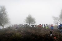 quite a crowd awaits the riders up the extremely wet, cold & misty Cole di Mortirolo <br /> <br /> Stage 16: Lovere to Ponte di Legno (194km)<br /> 102nd Giro d'Italia 2019<br /> <br /> ©kramon