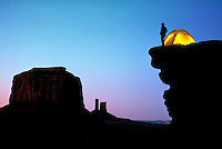 A camper enjoys the spectacular view from his camp site at Monument Valley, Arizona. Monument Valley Arizona USA.