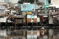 The prosperous business district of central Makati dwarfs a typical slum area of Manila where families commonly have between 6- 12 children. There is no family planning available from the Government due to a law passed by the Mayor and they are too poor to pay for their own contraception.