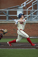Mitchell Garrity (7) of the Dayton Flyers follows through on his swing against the Campbell Camels at Jim Perry Stadium on February 28, 2021 in Buies Creek, North Carolina. The Camels defeated the Flyers 11-2. (Brian Westerholt/Four Seam Images)