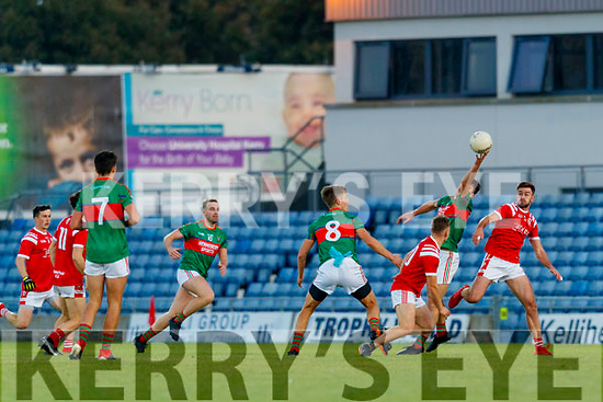 Mike Breen, Mid Kerry in action against Brendan O'Keeffe, East Kerry during the Kerry County Senior Football Championship Final match between East Kerry and Mid Kerry at Austin Stack Park in Tralee on Saturday night.