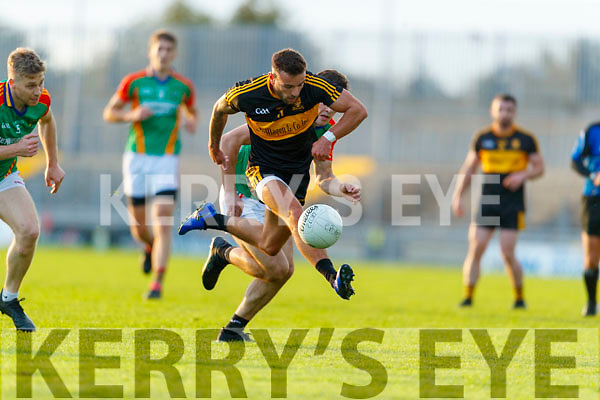 Micheál Burns, Dr. Crokes in action against Mike Breen, Mid Kerry during the Kerry County Senior Football Championship Semi-Final match between Mid Kerry and Dr Crokes at Austin Stack Park in Tralee, Kerry.