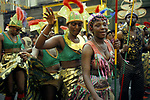 Notting Hill annual carnival west London. Black British women dancing in the street during the parade in costume UK  1970s 1979