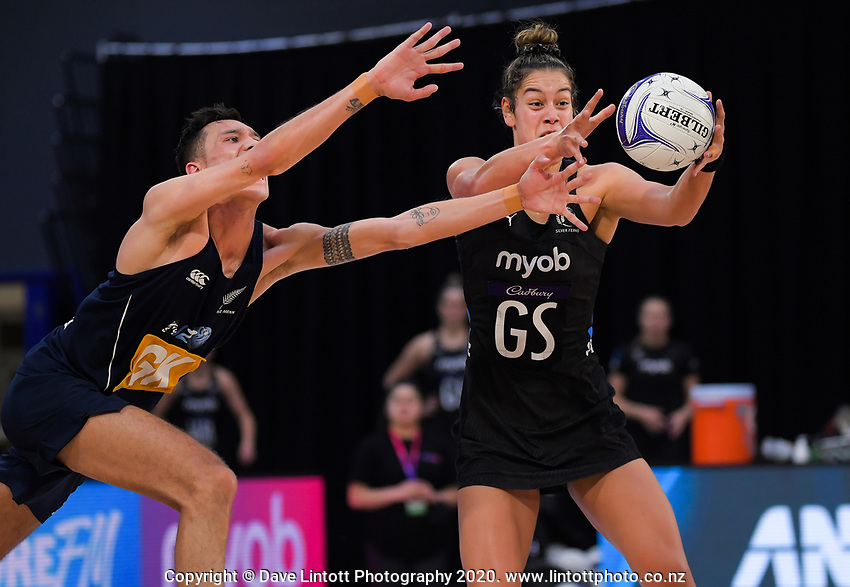 Silver Ferns goalshoot Maia Wilson takes a pass under pressure from Tim Apisai during the Cadbury Netball Series final between NZ Silver Ferns and NZ Men at the Fly Palmy Arena in Palmerston North, New Zealand on Saturday, 24 October 2020. Photo: Dave Lintott / lintottphoto.co.nz