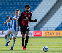 13th April 2021; The John Smiths Stadium, Huddersfield, Yorkshire, England; English Football League Championship Football, Huddersfield Town versus Bournemouth; Philip Billing of Bournemouth on the ball as Jonathan Hogg of Huddersfield Town tries to intercept  Strictly Editorial Use Only. No use with unauthorized audio, video, data, fixture lists, club/league logos or 'live' services. Online in-match use limited to 120 images, no video emulation. No use in betting, games or single club/league/player publications