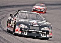 Dale Earnhardt leads Ricky Rudd out of turn two at Phoenix in November 2000. (Photo by Brian Cleary/www.bcpix.com)
